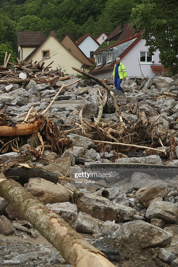 A man stands among boulders, smashed trees and other debris that cover a street in the village center following a furious flash flood the night before on May 30, 2016 in Braunsbach, Germany. The flood tore through Braunsbach, crushing cars, ripping corners of houses and flooding homes during a storm that hit southwestern Germany. Miraculously no one in Braunsbach was killed, though three people died as a result of the storm in other parts of the country.
