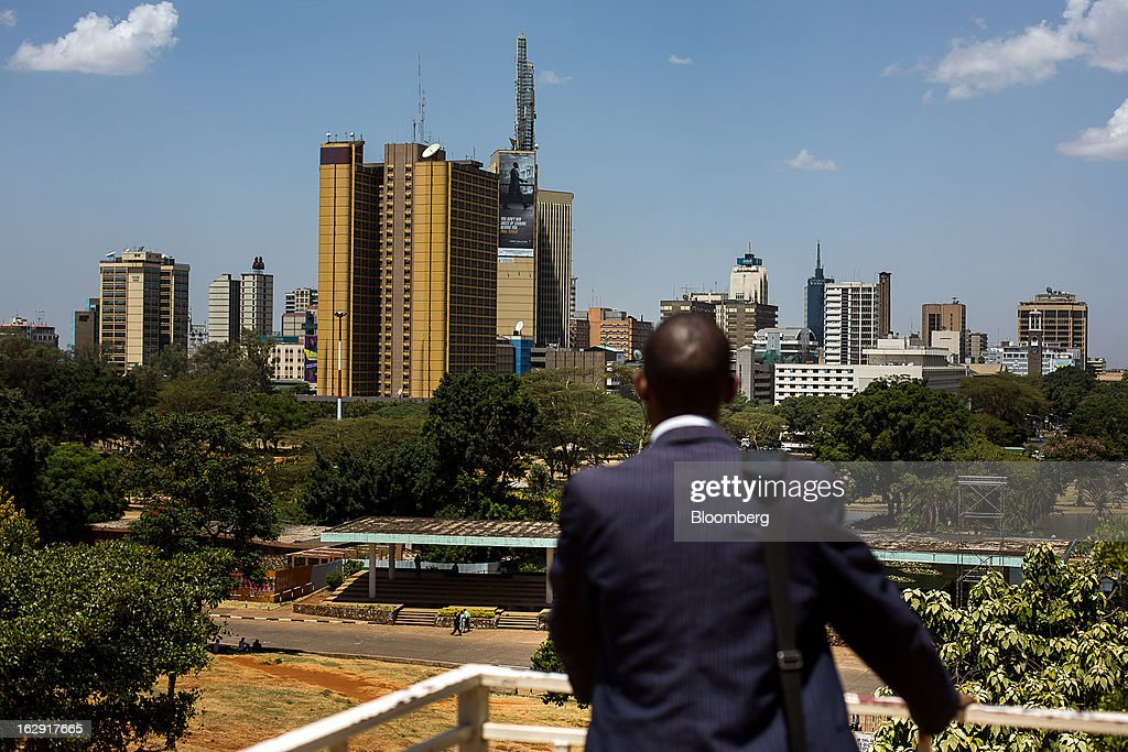 A man stands and looks out across the city skyline in Nairobi, Kenya, on Friday, March 1, 2013. Next week's presidential vote will be the first since disputed elections in 2007 triggered ethnic fighting in which more than 1,100 people died and another 350,000 fled their homes. Photographer: Trevor Snapp/Bloomberg via Getty Images
