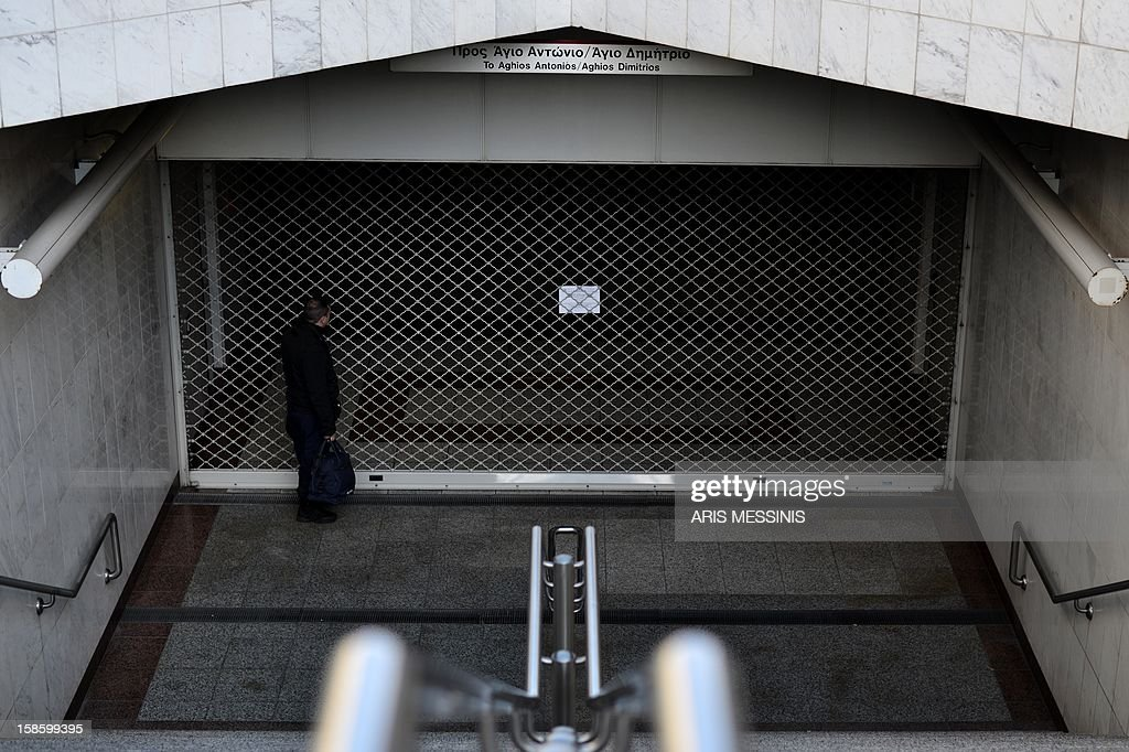 A man stands at a closed entrance of a subway station in the center of Athens on December 20, 2012 during a 24-hour strike of employees of the Athens Metro, tramway and a suburban railway. Greece opened its Christmas stockings early this year with an unexpected debt rating boon and European Central Bank support but analysts warn that risks remain in the troubled nation's fragile fiscal recovery.