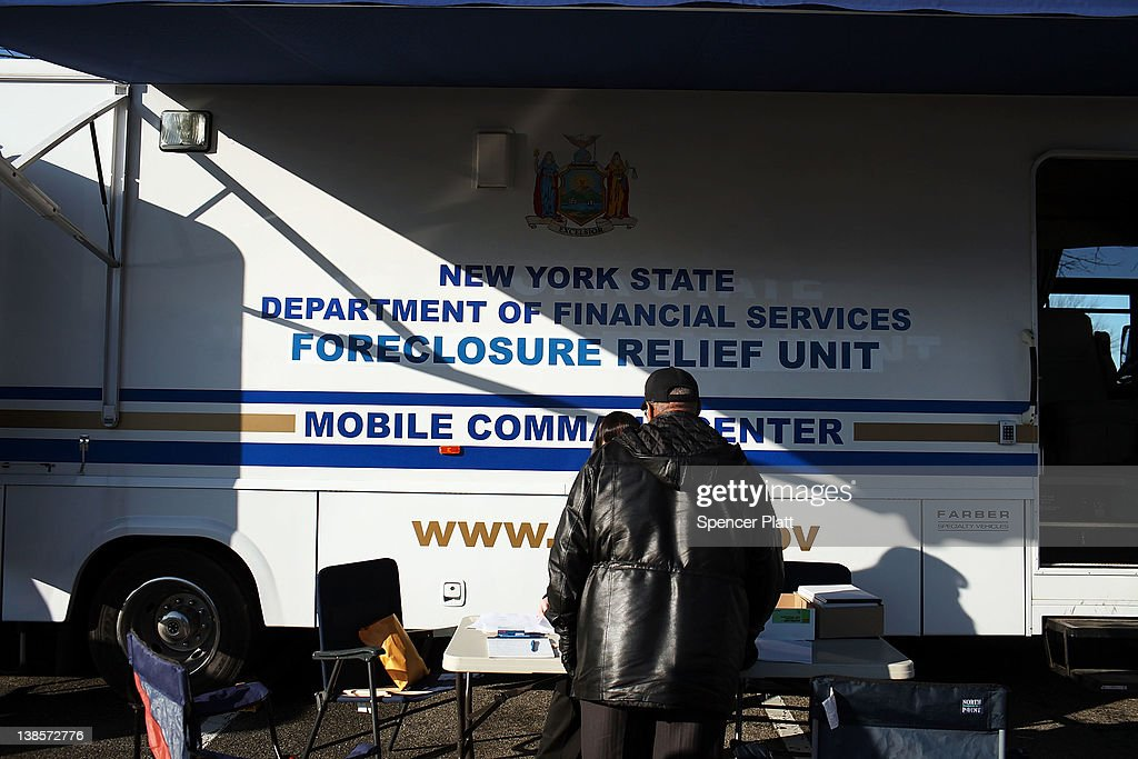 A man stands at a table in front of a New York State Department of Financial Services Foreclosure Relief Unit on February 9, 2012 in Islip, New York. The mobile van provides individuals who are facing foreclosure with counselors who can assess where homeowners are in the pre-foreclosure or foreclosure process. The mobile unit, which is equipped with computers and communications, looks to slow the number of foreclosures in the state and to provide information about loan modifications available to homeowners under federal law. Islip, which is located in Suffolk County, has the highest foreclosure rate in New York State.