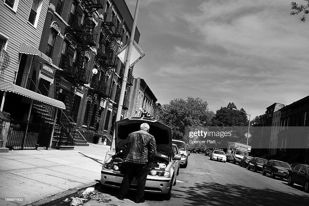 A man stands at his car near the address where Nathaniel Cash was murdered in 1991 in Bedford-Stuyvesant on May 16, 2013 in Brooklyn borough of New York City. Derrick Hamilton, who spent nearly 21 years in prison for the 1991 murder, was paroled in 2011 after questions surfaced about New York City Detective Louis Scarcella and lead witnesses on the case. Following the recent clearing of David Ranta of murder after serving a 23-year prison sentence, the Brooklyn, N.Y. District Attorney is reviewing 50 murder cases investigated by celebrated Detective Louis Scarcella. The review of cases will give special scrutiny to those cases which appear weakest. Scarcella, 61 and now retired, denies ever having used unethical tactics to secure a conviction.