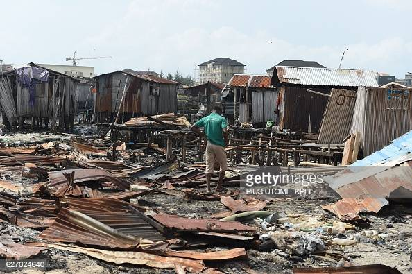 A man stands at his makeshift home demolished at Otodo Gbame waterfront fishing communities in Lagos on November 28 2016 Otodo Gbame a fishing...