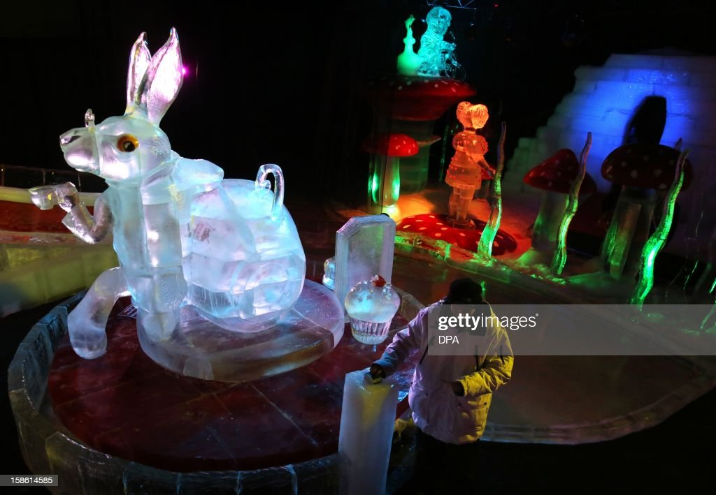 A man stands at the 'Alice's Adventures in Wonderland' scenery built of ice at an adventure farm in Roevershagen, northern Germany, on December 21, 2012. The ice sculptures partly made of red ice are on exhibition until March 3, 2013.