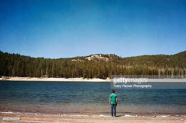 A man stands at the edge of Horseshoe Lake