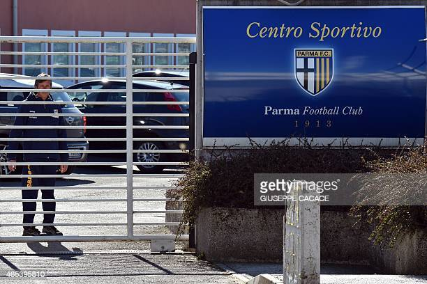 A man stands at the entrance of the Parma FC training centre in Collecchio near Parma on March 6 2015 The Italian professional football league voted...