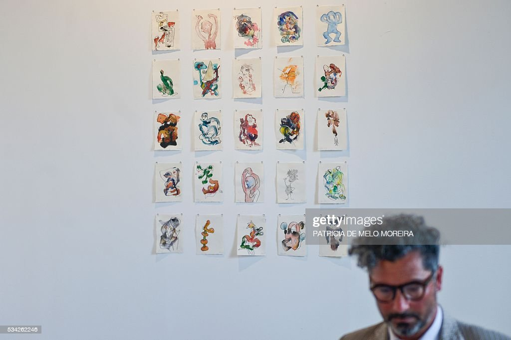 A man stands at the Portuguese-French gallery 'Anne Barrault; Caroline Pages; Manuela Marques ' stand during the ARCO Lisbon Contemporary Art Fair in Lisbon on May 25, 2016. ARCO will be open to the public from May 26 to 29. / AFP / PATRICIA