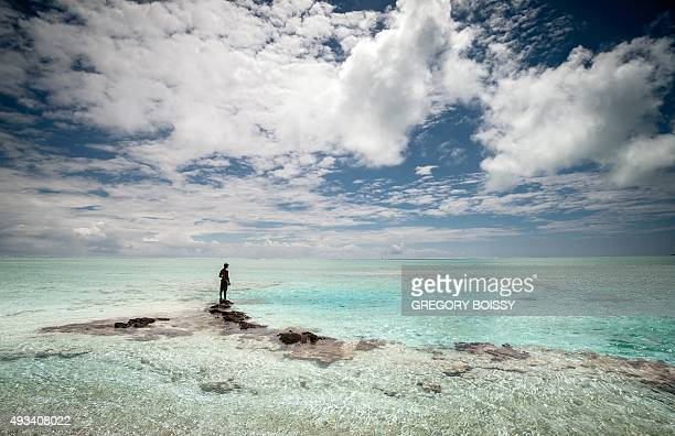 A man stands at the Tagoi motu near the Toau atoll about 400 kilometres from Tahiti in the Tuamotu Archipelago in the French polynesia on October 14...