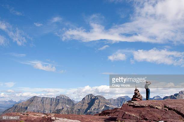 A man stands at the top of Comeau Pass in Glacier National Park, Montana.