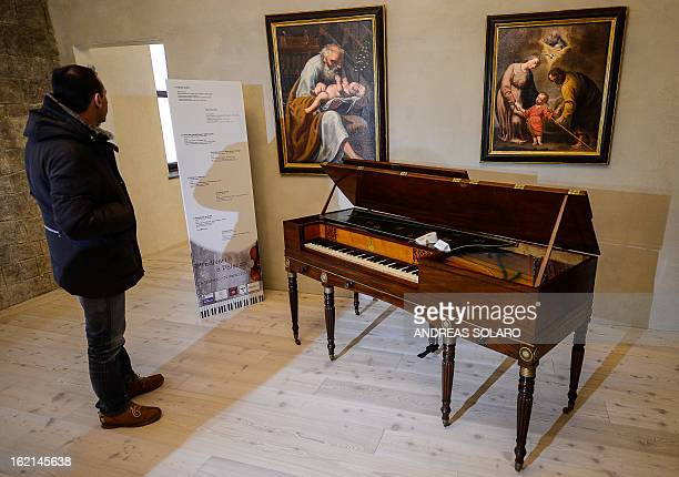 A man stands by a 1813 London Square piano made by Italian Muzio Clementi known as the 'Father of the Piano' at the museum of the 'Magnifica Comunità...