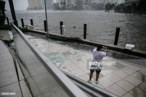 A man stands by the Miami river as the water lever surges during the passing of Hurricane Irma in Miami Fla on Sept 10 2017