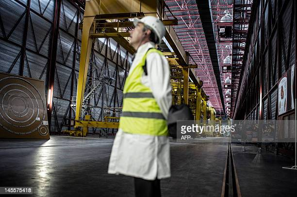A man stands in a corridor of the Eurodif SA/George Besse 1 uranium enrichment plant on May 31 2012 in SaintPaulTroisChateaux southeastern France The...