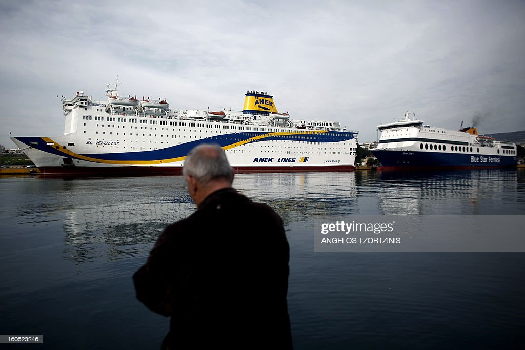A man stands in front of a docked ferry at the port of Piraeus, near Athens, during a 48-hours strike on February 2, 2013. Sailors kicked off a two-day walkout, buses and trains were at a standstill and civil servants planned to hold a three-hour work stoppage against the government's cutbacks.