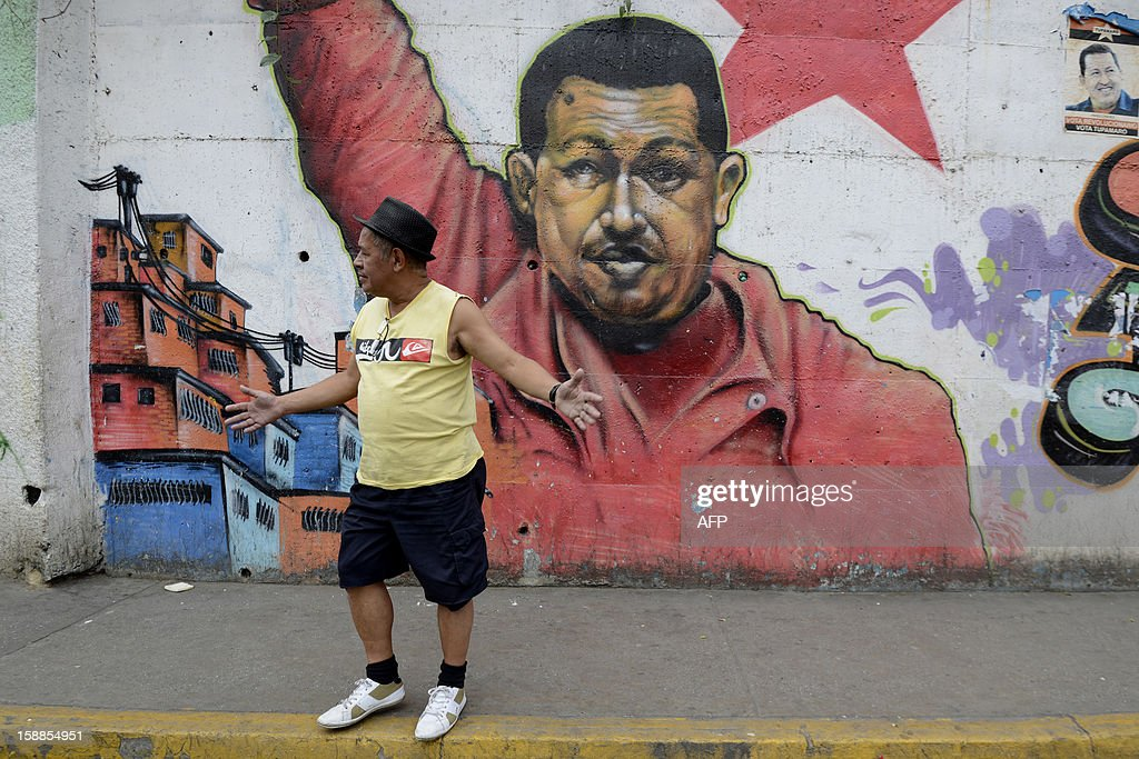 A man stands in front of a mural of Venezuelan President Hugo Chavez in Caracas were the streets are practically deserted on January 1, 2013. Somber Venezuelans began 2013 fretting over their ubiquitous and garrulous leader Hugo Chavez, wondering what the future holds as the president wages a tough battle with cancer in a Havana hospital. New Year's Eve revelry was tempered, and official acts -- two open air concerts -- were canceled outright out of respect for the ex-paratrooper who has dominated this oil-rich country so thoroughly since taking power in 1999. Chavez underwent his fourth cancer-related surgery three weeks ago in Havana and has been bed-ridden ever since. Information on his condition is scant, with the government admitting only to 'complications' in his recovery.