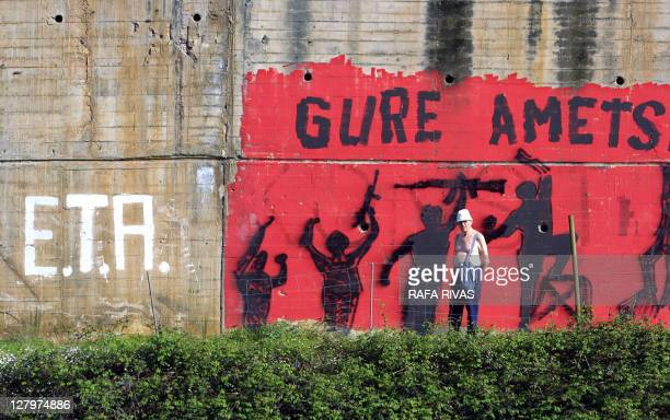 A man stands in front of a mural painting about ETA proindependence Basque violent group that reads in Basque 'Our Dream' 23 April 2002 in the...