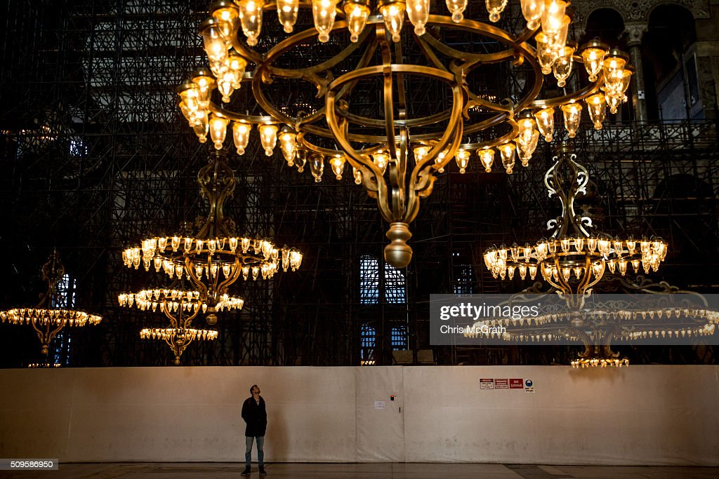 A man stands in front of construction boarding as he views the interior of the Hagia Sophia Museum on February 11, 2016 in Istanbul, Turkey. The Hagia Sophia (Ayasofya) Museum is one of the most visited tourist attractions in Turkey, with more than 3 million visitors per year. Constructed in 537 the museum originally served as an Orthodox Cathedral, later a Roman Catholic church and was converted into a mosque when Constantinople was conquered by the Ottoman Turks in 1453. In 1935 it was opened as a museum by the Republic of Turkey. The museum is currently undergoing restoration on various parts of the interior.