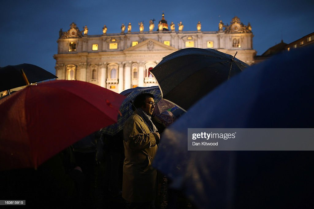 A man stands in front of St Peter's Basilica in St. Peter's Square after white smoke billowed out of the chimney signifying that the Cardinals in the Conclave have come to a decision on a new Pope on March 13, 2013 in Vatican City, Vatican. Argentinian Cardinal Jorge Mario Bergoglio was elected as the 266th Pontiff and will lead the world's 1.2 billion Catholics.
