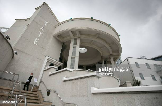 A man stands in front of the exterior of the Tate St Ives which is set to reopen to the public this weekend after a fouryear £20 million...