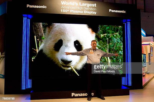 A man stands in front of the Panasonic 150 inch plasma display that was showcased at the 2008 International Consumer Electronics Show at the Las...