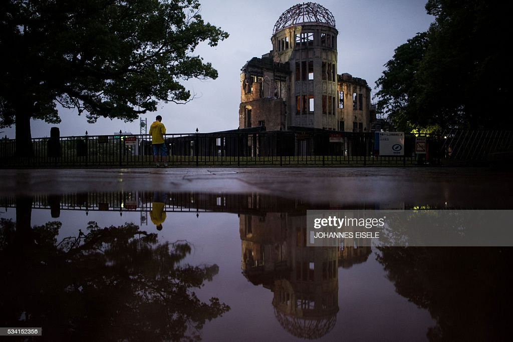 A man stands in front of the Peace Memorial Genbaku Dome in the Hiroshima Peace Memorial park in Naka Ward, Hiroshima Prefecture on May 25, 2016. US President Barack Obama is set to become the first sitting US president to visit Hiroshima when he journeys on May 27 with Japanese Prime Minister Shinzo Abe, hallowed ground to Japanese but, for more than 70 years, a no-go zone for 11 of his Oval Office predecessors. / AFP / JOHANNES