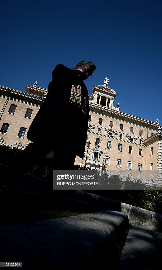 A man stands in front of the Vatican government palace, the Palazzo del Governatorato, at the Vatican City State on February 19, 2013. Pope Benedict XVI will be hosted in the convent of Mater Ecclesiae (Mother of the Church) offering him a substantial four-story modern home complete with contemporary chapel, garden and a roof terrace looking out from a rise dominated by the Holy See's TV transmission tower. Pope Benedict XVI began a week-long spiritual retreat out of the public eye on Monday ahead of his resignation on February 28 with the field of candidates to succeed him still wide open. AFP PHOTO/ Filippo MONTEFORTE