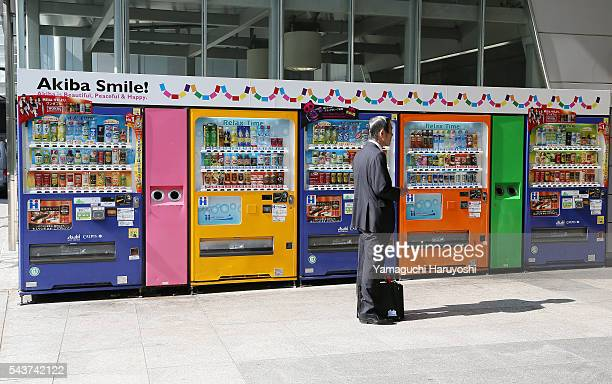 A man stands in front of the vending machines in the Akihabara district of Tokyo Japan Nov 1 2013 Akihabara also called Akiba after a former local...