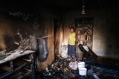 A man stands in his burned flat after shelling in the town of Yasynuvata near the rebel stronghold of Donetsk on August 12 2014 Shelling on a town...