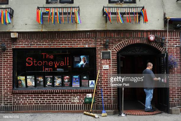 A man stands in the doorway of the historic gay bar The Stonewall Inn days after Mark Carson was killed after a man yelled homophobic slurs at him...
