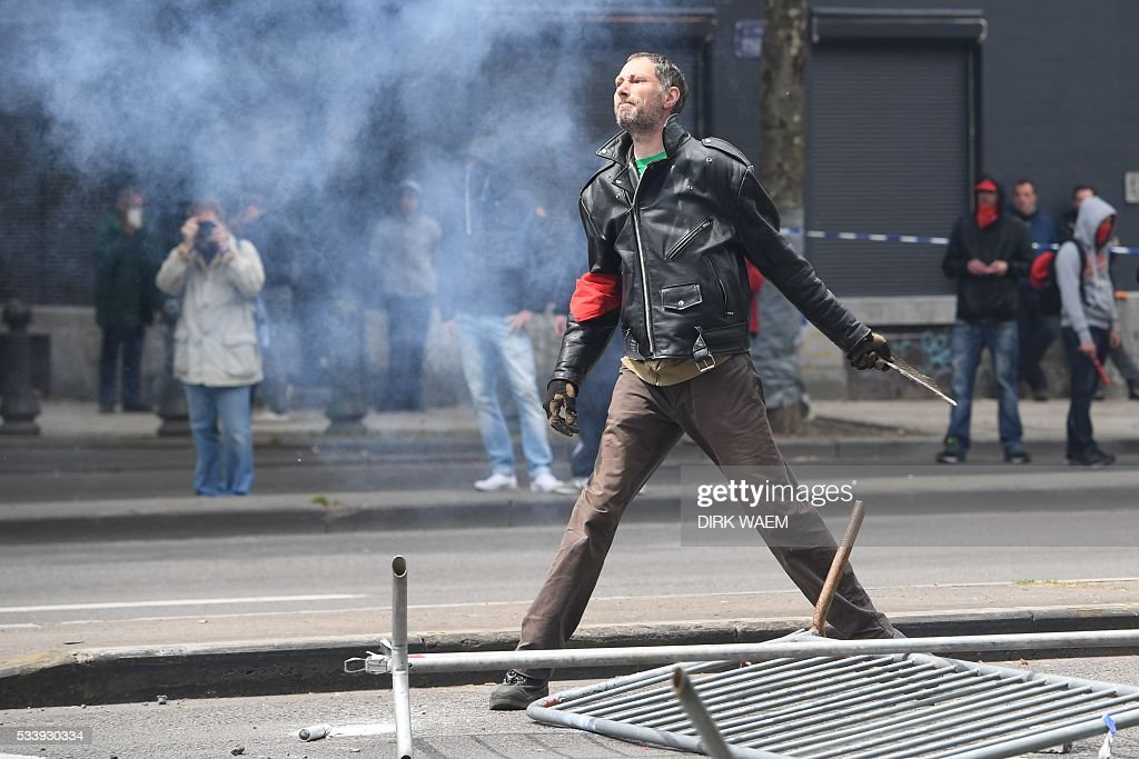 A man stands in the streets as he protests during a national anti-austerity demonstration on May 24, 2016, in Brussels Belgian trade unions called for mass protests against the centre-right government's proposed work reforms as they plan rallies and strikes over the next few months. / AFP / Belga / DIRK WAEM / Belgium OUT