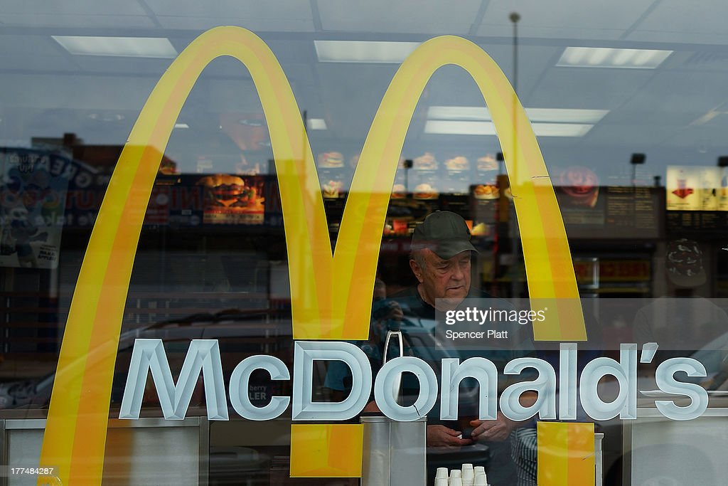 A man stands inside a McDonald's fast food restaurant on August 23 2013 in the Brooklyn borough of New York City The fast food industry has been...