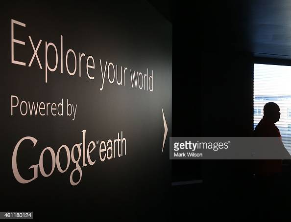 A man stands near a Google Earth exhibit at Google's Washington headquarters January 8 2015 in Washington DC Google held a news conference with...