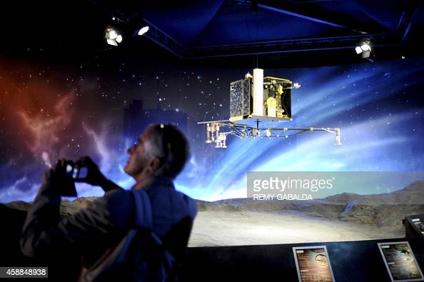 A man stands near a model of the european space agency 39 s for Espace stand