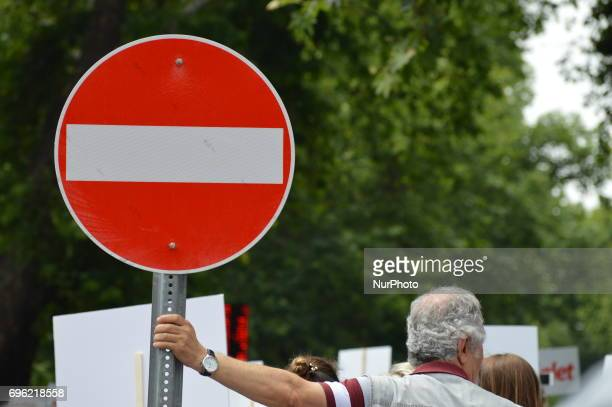 A man stands near a traffic sign during the 'Justice March' to protest against the Turkish government held by the main opposition Republican People's...