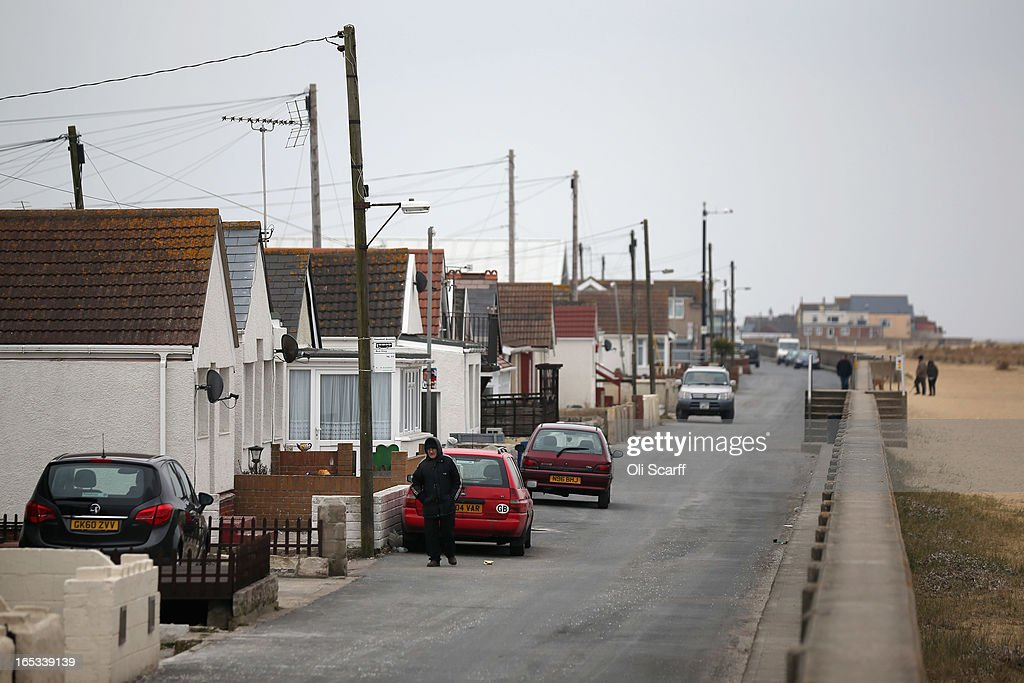 A man stands near dilapidated properties stand in the seaside town of East Jaywick, the most deprived place in England, on April 3, 2013 in Jaywick, England. The Government's 2011 Indices of Multiple Deprivation' measure ranks Jaywick as the most deprived of all 32,482 small wards in England and Wales. The area also has the greatest number of young people not in employment, education or training; one third of 16 to 24 year-olds claim Jobseeker's Allowance, compared to the national average of 6 per cent. Changes to the benefits and tax system which came into force on April 1, 2013 have included a cut in housing benefit payments for working-age social housing tenants whose property is deemed larger than they need and council tax support payments now being administered locally.