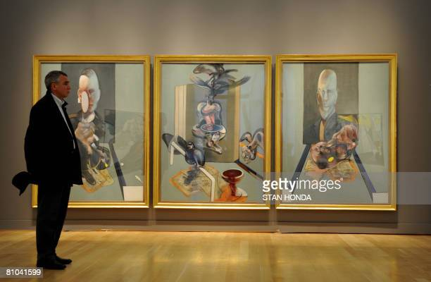 A man stands near Francis Bacon's 'Triptych' 1976 on display May 9 2008 during a preview of the spring sale of Contemporary Art at Sotheby's in New...