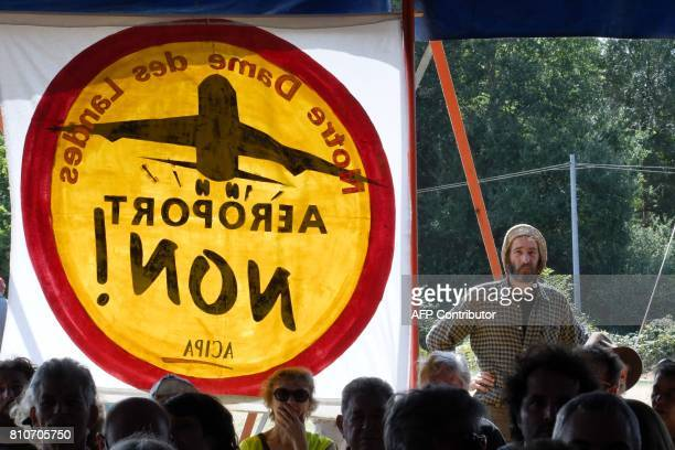 A man stands next to a sign reading 'Airport no' during a twoday meeting organised by opponents to a controversial international airport project in...