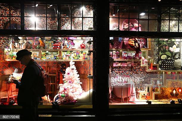 A man stands next to a window of the Liberty's store on December 16 2015 in London EnglandRetail Sales for November 2015 have increased by 17%...