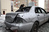 A man stands next to his car destroyed after shelling between Ukrainian army and proRussian separatists in the eastern Ukrainian city of Donetsk on...