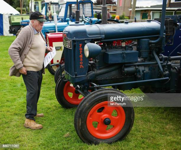 A man stands next to his vintage tractor during the 194th Sedgefield Show on August 12 2017 in Sedgefield England The annual show is held on the...
