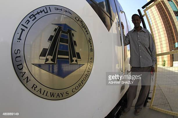 A man stands next to Sudan's new Nile Train in Khartoum on March 17 2014 In a dilapidated povertystricken country where some railway rolling stock is...