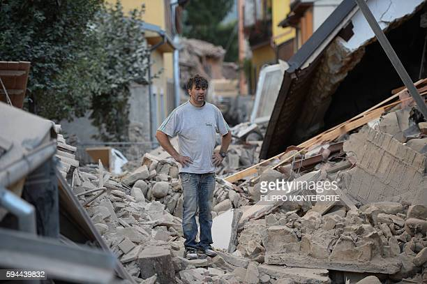 TOPSHOT A man stands on a damaged home after a strong earthquake hit Amatrice on August 24 2016 Central Italy was struck by a powerful 62magnitude...