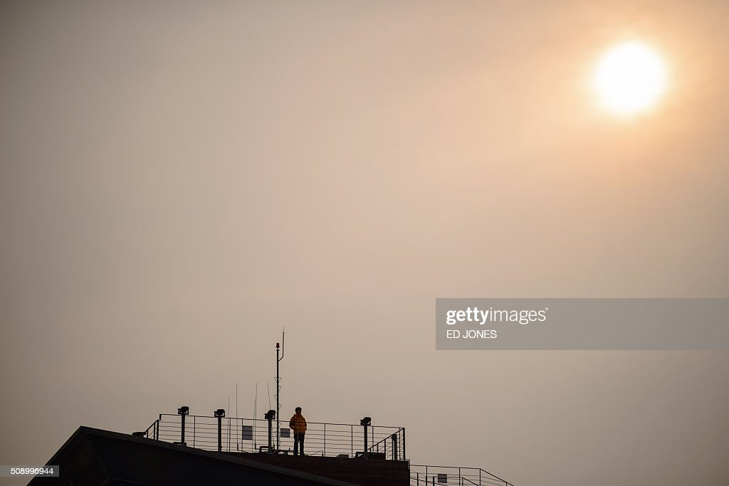 A man stands on a viewing platform near the Demilitarized Zone (DMZ) separating North and South Korea, in Imjingak on February 8, 2016. Some South Korean families separated during the Korean war visited the DMZ to offer prayers to their relatives in the North on the occasion of the Lunar New Year. AFP PHOTO / Ed Jones / AFP / ED JONES