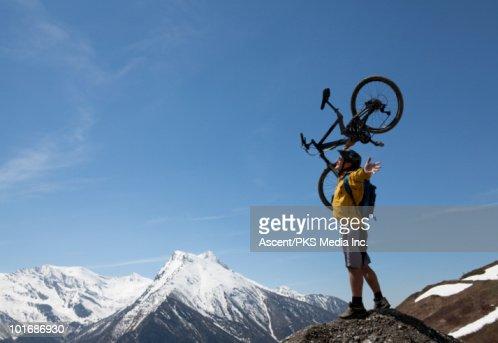 Woman Stands On High Mtn Ridge Beside Mtn Bike Stock Photo Getty