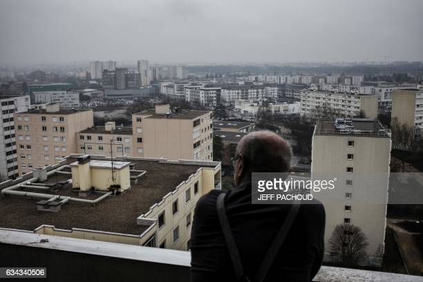 A man stands on his balcony in VaulxenVelin on February 7 2017 VaulxenVelin regularly appears among the list of French cities with the lowest voter...