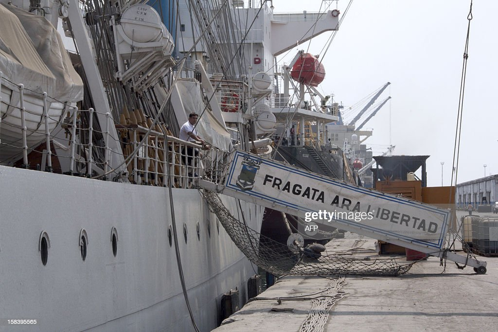 A man stands on the deck of the Argentinian frigate 'Libertad' on December 15, 2012 at the port of Tema. An international tribunal in Hamburg called on Ghana to immediately release an Argentine navy tall ship, which it has held for more than two months in a debt dispute. The Libertad -- a three-masted sailing vessel -- has been docked at the port of Tema east of Accra since October 2, under a Ghanaian court order requested by NML Capital, a Cayman Islands investment firm that says Argentina owes it $370 million.