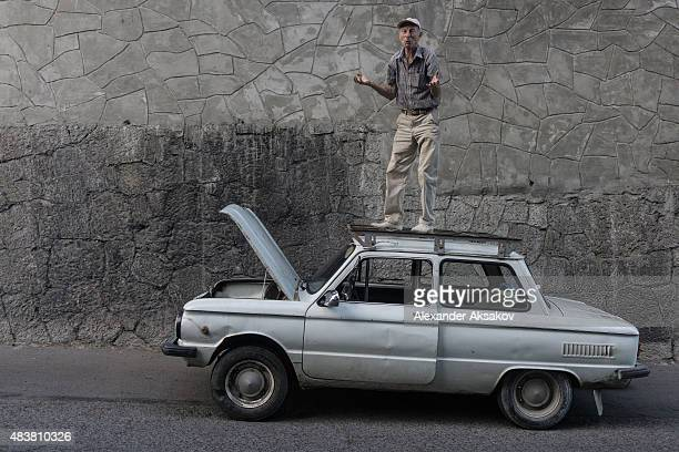Man stands on the top of his car on August 10 2015 in Yalta Crimea Russian President Vladimir Putin signed a bill in March 2014 to annexe the Crimean...