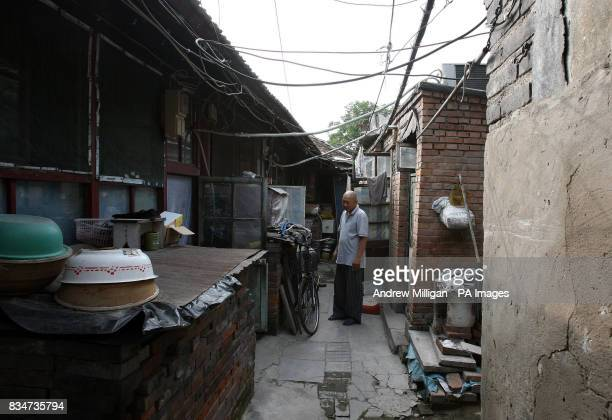 A man stands out side his Hutong near Hou Hai lake in Old Beijing China