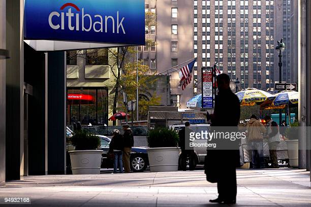 A man stands outside a Citibank branch located in the headquarters of Citigroup Inc in New York US on Monday Nov 17 2008 Citigroup Inc the US bank...