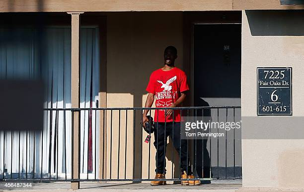 A man stands outside a unit a the Ivy Apartments where the confirmed Ebola virus patient was staying is seen on October 1 2014 in Dallas Texas The...