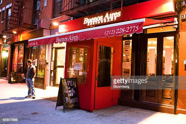 A man stands outside of the Buenos Aires restaurant in New York US on Monday March 16 2009 Walls bedecked with soccer posters photos of tango dancers...