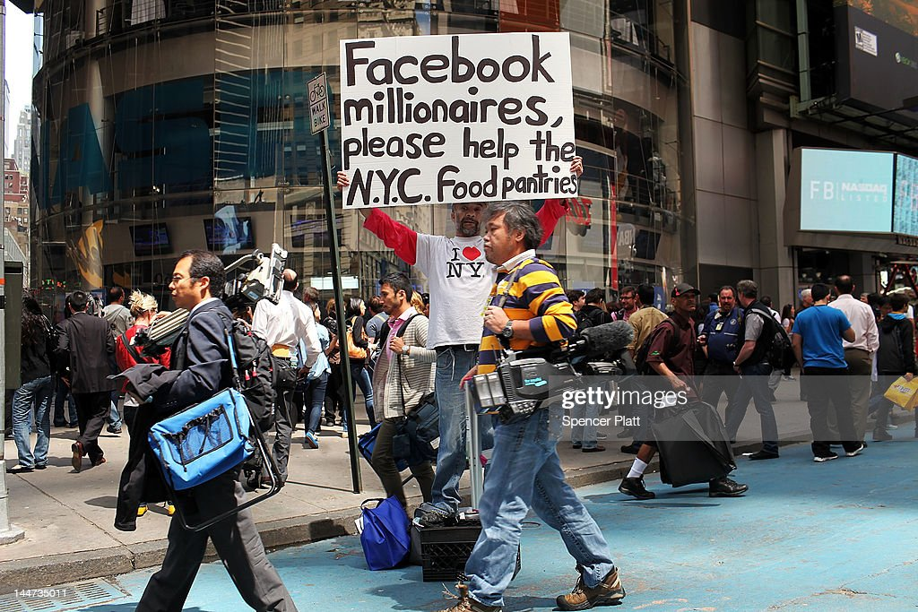 A man stands outside of the Nasdaq stock market with a sign moments after Facebook stock went public on May 18, 2012 in New York, United States. The social network site began trading after 11:30 a.m. with shares jumping 13% to $43 before quickly falling. On Thursday Facebook priced 421 million shares at $38 each. Facebook, a Menlo Park, California based company, will have a valuation exceeding $100 billion.